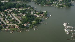 AX73_047 - 5K stock footage aerial video of riverfront homes by Sue Creek in Baltimore, Maryland