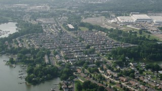 AX73_049 - 5K stock footage aerial video of row houses by the water in Middle River, Maryland