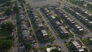 AX73_058 - 5K stock footage aerial video of a neighborhood with row houses in Baltimore, Maryland