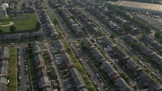 AX73_059 - 5K stock footage aerial video flying over a neighborhood of row houses in Baltimore, Maryland