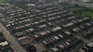 AX73_060 - 5K stock footage aerial video flying by a neighborhood of row houses in Baltimore, Maryland