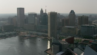 AX73_069 - 5K stock footage aerial video flying by Harborplace and Downtown Baltimore skyscrapers, Maryland