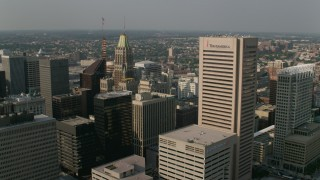 AX73_071 - 5K stock footage aerial video of the Bank of America Building and the Transamerica Tower in Downtown Baltimore, Maryland