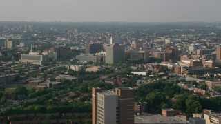 AX73_072 - 5K stock footage aerial video of office buildings and public housing in Baltimore, Maryland