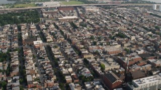 AX73_081 - 5K stock footage aerial video flying over urban town homes in Baltimore, Maryland