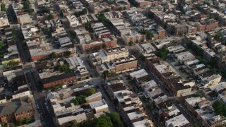 AX73_082 - 5K stock footage aerial video flying over townhouses and apartment buildings in Baltimore, Maryland