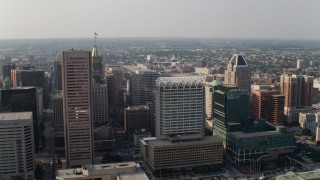 AX73_086 - 5K stock footage aerial video flying by Transamerica Tower, 100 East Pratt Street, and The Gallery Mall and office tower in Downtown Baltimore, Maryland