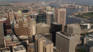 AX73_091 - 5K stock footage aerial video passing skyscrapers in Downtown Baltimore, Maryland