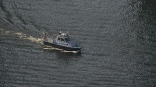AX73_094 - 5K stock footage aerial video of a police boat on the Patapsco River in Baltimore, Maryland