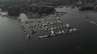 AX73_100 - 5K stock footage aerial video approaching Henderson's Wharf Marina on the Patapsco River in Baltimore, Maryland