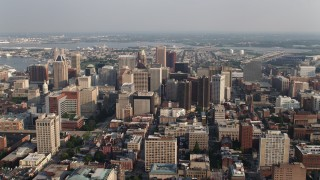 AX73_106 - 5K stock footage aerial video flying by tall skyscrapers in Downtown Baltimore, Maryland