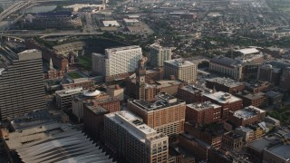 AX73_109 - 5K stock footage aerial video approaching Emerson Bromo-Seltzer Tower, Baltimore Hilton, and Oriole Park in Downtown Baltimore, Maryland