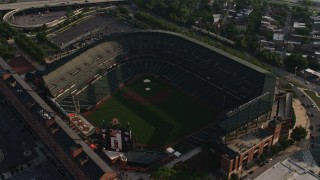 AX73_110 - 5K stock footage aerial video flying over Baltimore Hilton for a view of Oriole Park at Camden Yards, Downtown Baltimore, Maryland