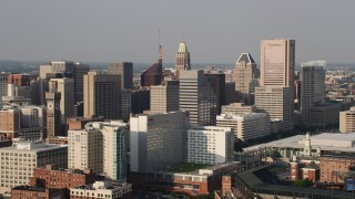 AX73_116 - 5K stock footage aerial video of Emerson Tower and Downtown Baltimore skyscrapers, Maryland