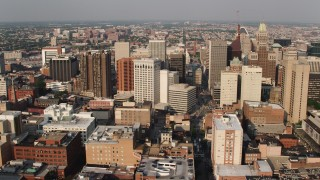 AX73_118 - 5K stock footage aerial video passing by Downtown Baltimore's skyscrapers, Maryland