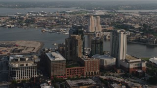 AX73_122 - 5K stock footage aerial video of riverfront hotels, Legg Mason Tower, and office buildings in Downtown Baltimore, Maryland