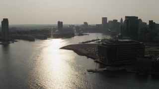 AX73_126 - 5K stock footage aerial video following Patapsco River to approach the Inner Harbor and Downtown Baltimore skyscrapers, Maryland