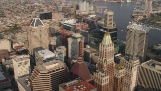 AX73_133 - 5K stock footage aerial video orbiting tops of Schaefer Tower and the Bank of America Building in Downtown Baltimore, Maryland