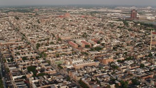 AX73_137 - 5K stock footage aerial video flying over urban apartment buildings and town homes in Baltimore, Maryland