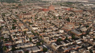 AX73_138 - 5K stock footage aerial video flying over urban apartments and town homes to approach Canton Middle School in Baltimore, Maryland