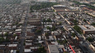 AX73_139 - 5K stock footage aerial video of urban town homes and Our Lady of Pompeii Church in Baltimore, Maryland