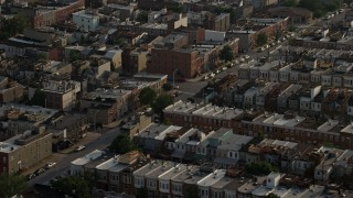 AX73_141 - 5K stock footage aerial video of urban row houses in Baltimore, Maryland