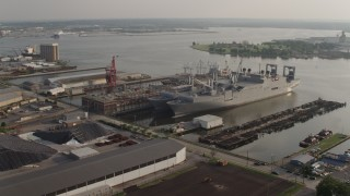 AX73_143 - 5K stock footage aerial video of Naval warships docked on the Patapsco River in Baltimore, Maryland