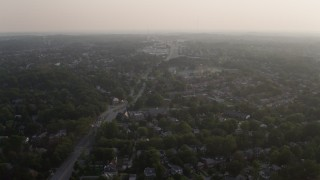 AX73_156 - 5K stock footage aerial video of row houses and suburbs at sunset, Baltimore, Maryland