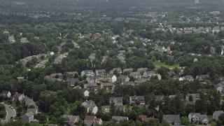 AX74_001 - 5K stock footage aerial video flying Over Suburban Neighborhoods in Manassas, Virginia