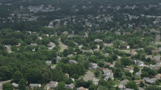AX74_002 - 5K stock footage aerial video flying Over Suburban Residential Neighborhoods in Manassas, Virginia