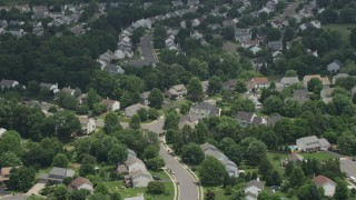 AX74_003 - 5K stock footage aerial video approaching and tilting to Spacious Homes and Streets in Manassas, Virginia