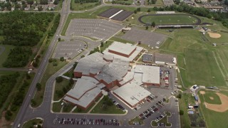 AX74_006 - 5K stock footage aerial video tilting to Bird's Eye of High School in Manassas, Virginia