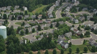 AX74_008 - 5K stock footage aerial video of suburban homes and streets in Manassas, Virginia