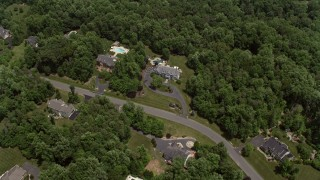 AX74_009 - 5K stock footage aerial video flying over spacious mansions mansions and tilt to one of the homes in Clifton, Virginia