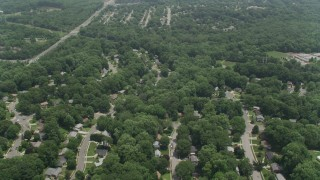 AX74_017 - 5K stock footage aerial video flying over residential suburbs in Springfield, Virginia