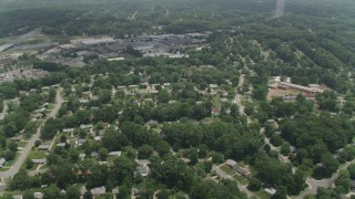 AX74_018 - 5K stock footage aerial video flying over a residential neighborhood near warehouses in Springfield, Virginie