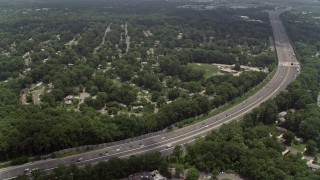 AX74_019 - 5K stock footage aerial video flying over freeway, approaching an elementary school in Springfield, Virginia