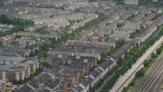 AX74_023 - 5K stock footage aerial video flying by row houses in Alexandria, Virginia