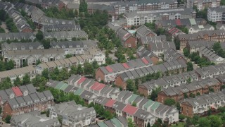 AX74_024 - 5K stock footage aerial video passing row houses in Alexandria, Virginia