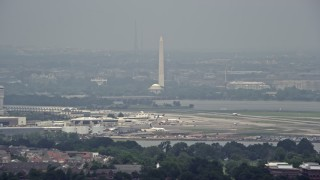 AX74_028 - 5K stock footage aerial video of White House, Washington Monument and Jefferson Memorial seen from Reagan National in Washington DC