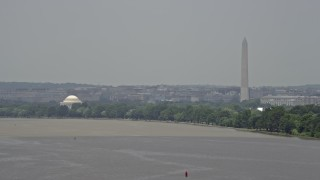 AX74_034 - 5K stock footage aerial video of the Jefferson Memorial and the Washington Monument seen from the Potomac River in Washington DC