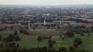 AX74_049 - 5K stock footage aerial video of schools and a football field in Washington D.C.