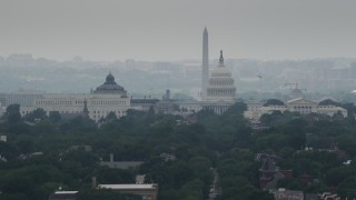 AX74_056 - 5K stock footage aerial video of the United States Capitol, Thomas Jefferson and John Adams Buildings, and the Washington Monument in Washington DC