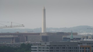 AX74_061 - 5K stock footage aerial video of the Washington Monument behind a tall construction crane in Washington DC