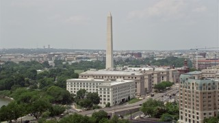 AX74_069 - 5K stock footage aerial video of Washington Monument near government office buildings on 14th Street in Washington DC