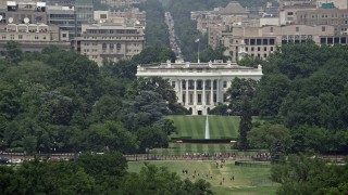 AX74_070E - 5K stock footage aerial video of The White House and South Lawn in Washington DC