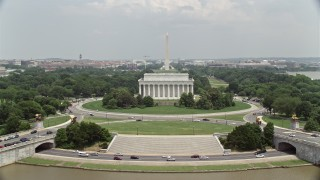 AX74_074 - 5K stock footage aerial video orbiting Lincoln Memorial to reveal the Reflecting Pool and Washington Monument in Washington DC