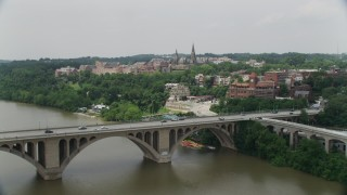 AX74_080 - 5K stock footage aerial video flying over Francis Scott Key Bridge to approach Georgetown University in Washington DC