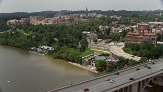 AX74_080E - 5K stock footage aerial video flying over Francis Scott Key Bridge to approach Georgetown University in Washington DC