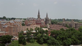 AX74_083 - 5K stock footage aerial video flying by Georgetown University in Washington DC